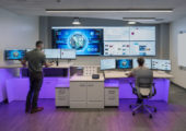 side by side sit-stand desks for operations center