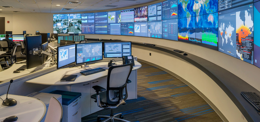 command center with curved video wall and white operations center consoles