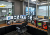 security operations center with view into adjacent conference room