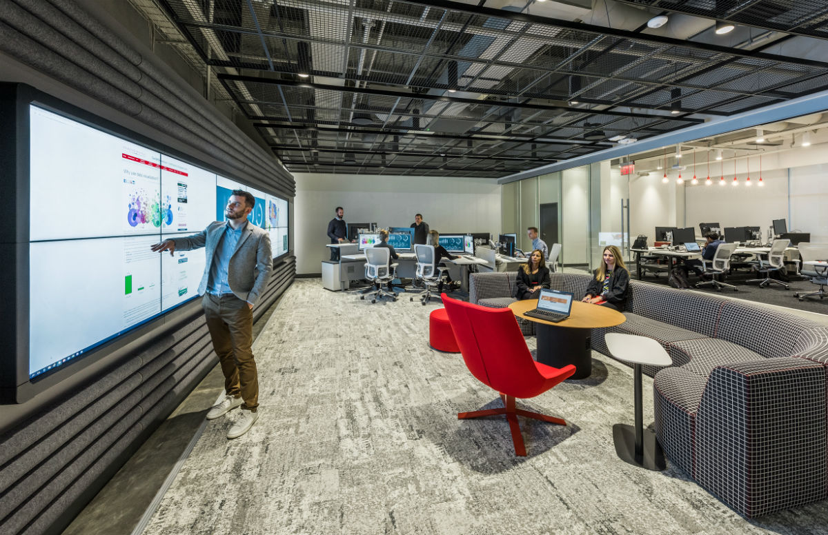 collaboration space with large video wall and modern furniture