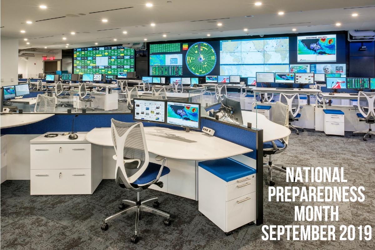 image of fleet operations center with command center consolesand video wall
